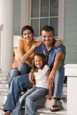 Young Family Sitting On Porch Image