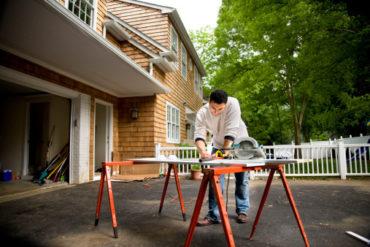 Man with circular saw doing home repairs photo